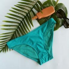 Donji deo ženskog kupaćeg kostima u tirkiznoj nijansi. HUNKEMOLLER